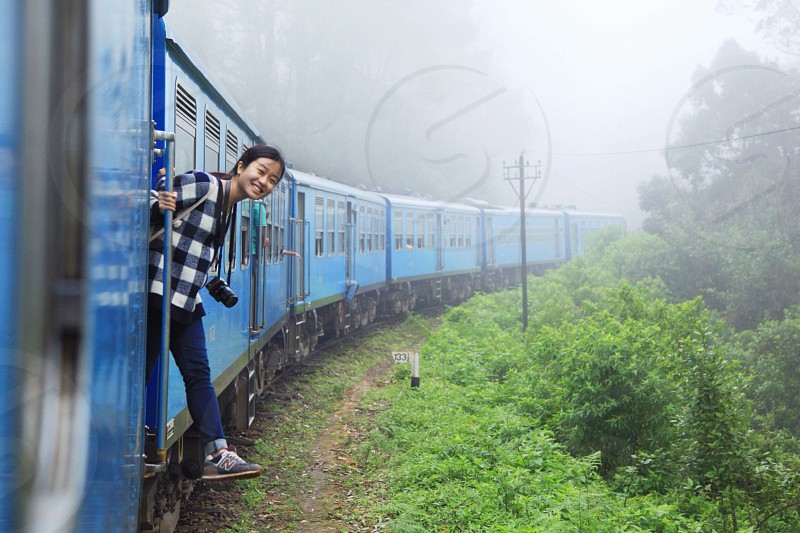woman looking on side of train photo