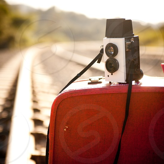 A camera sits on a suitcase on the railroad tracks in Simi Valley CA photo