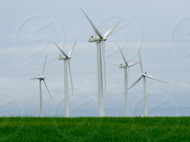 Green Energy in Wales. Wind turbines situated near Pendine Carmarthenshire Wales photo