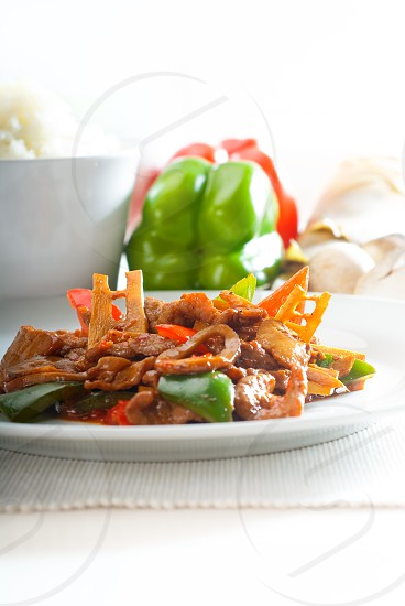 typical chinese dishfresh beef stir fried with pepperrs bamboo sprout and mushrooms photo