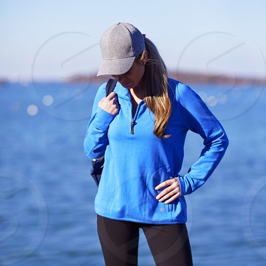 Getty image authentic people real life realistic everyday fashion harbor water travel explore hat girl woman style athletic visual storytelling photo