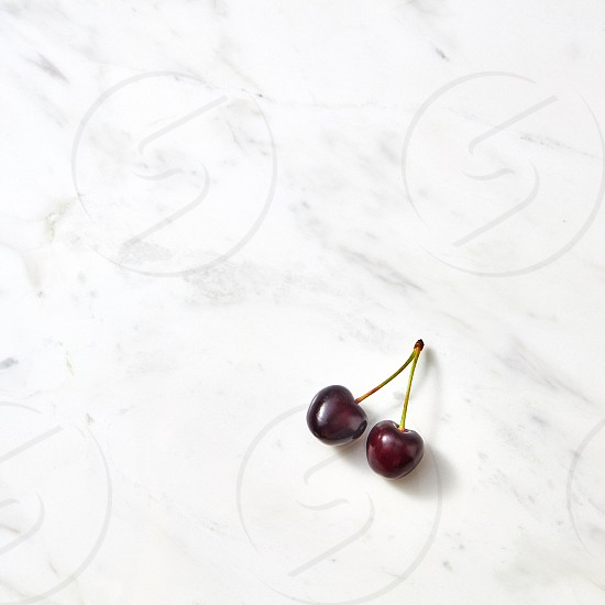 Summer cherries minimal background with place under text. Flat lay. photo