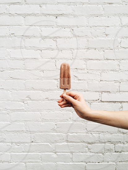 chocolate popsicle in hand photo