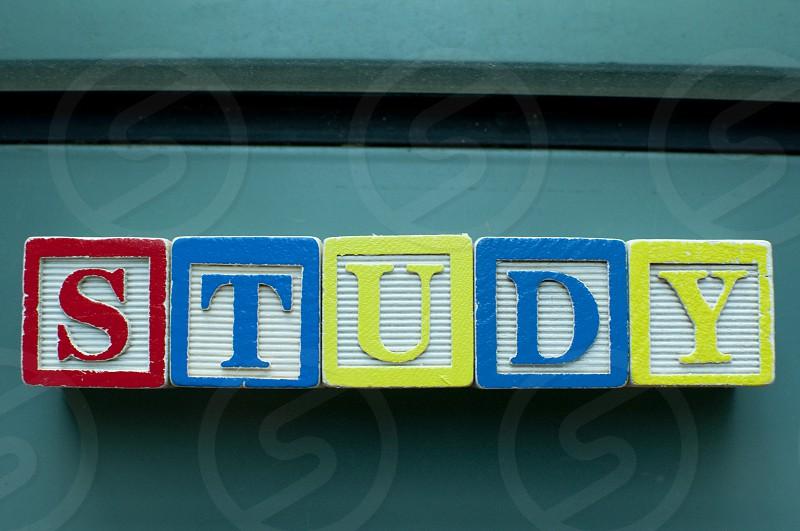 Study written on colorful toy blocks photo