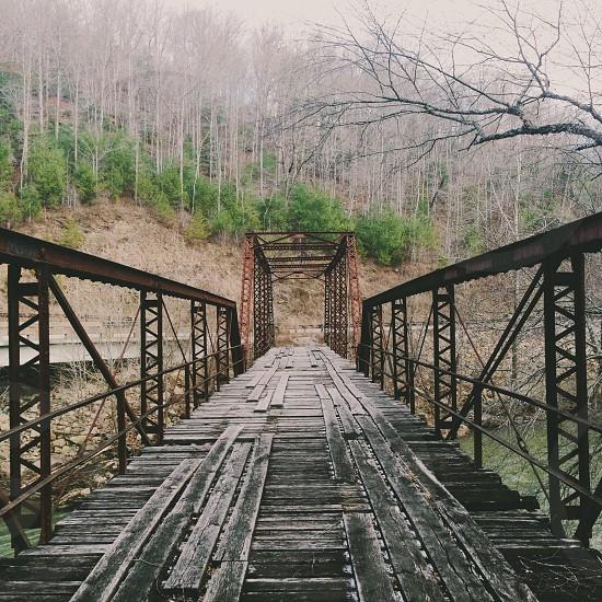 long metal and wood plank bridge photo
