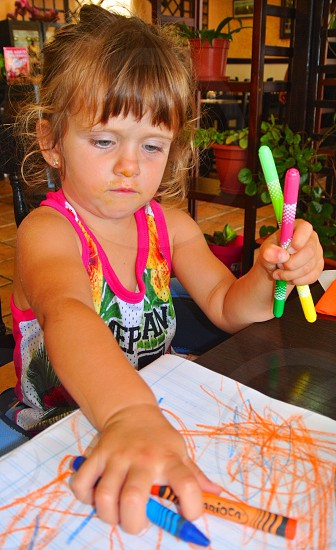 Young girl learning to paint photo