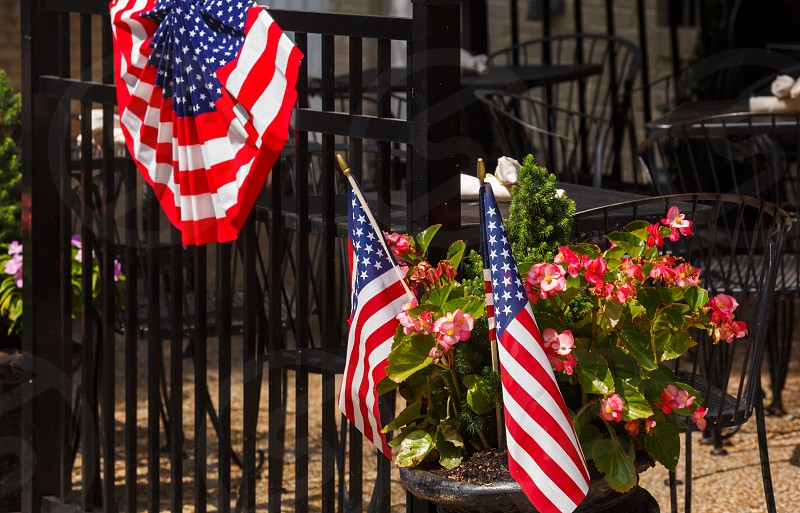 US flags at an outdoor cafe photo