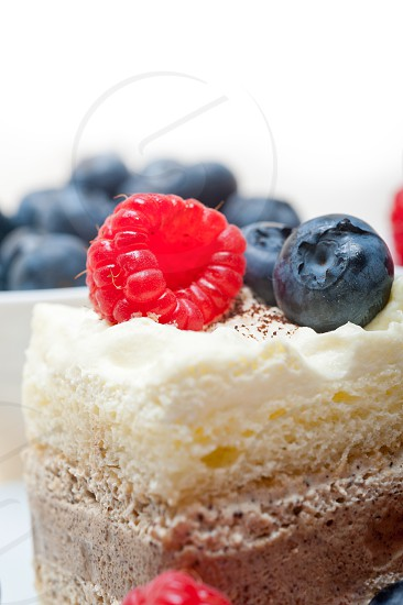 fresh homemade raspberry and blueberry cream cake  photo