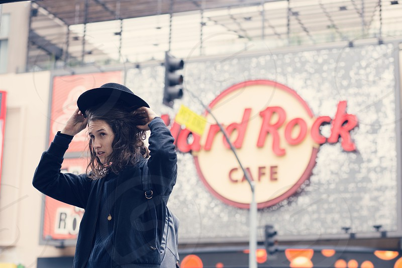 woman with curly hair with background of hard rock cafe photo