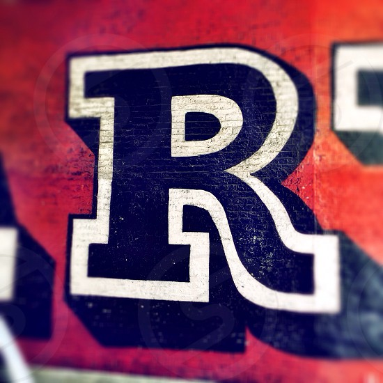 Letter R. Detail of street art by artist Ben Eine in Shoreditch London England.  photo