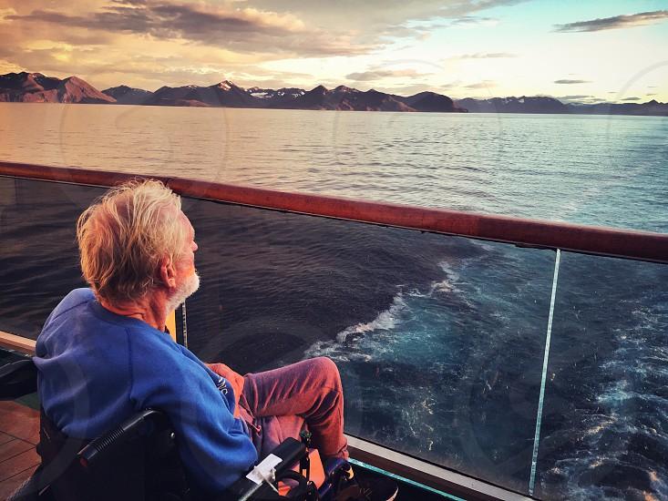 Elderly man on boat in Iceland  photo