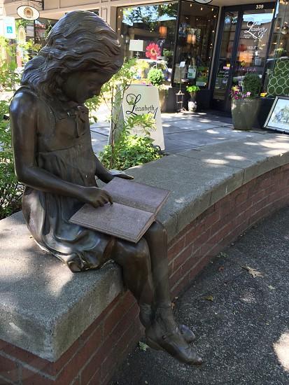 Statue of girl reading a book Camas Washington photo