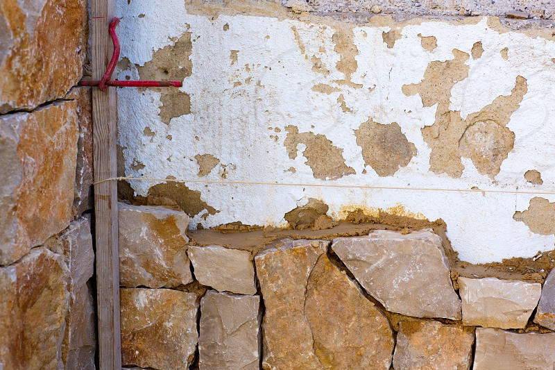 Masonry stone wall construcion process traditional stonework photo