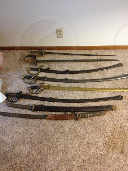 My father-in-law's sword collection. photo