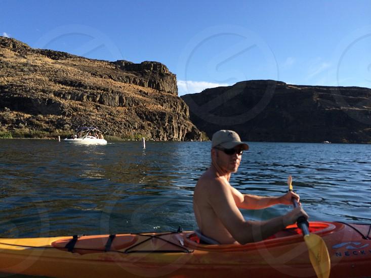 Man kayaking outdoor recreation lake summer  photo