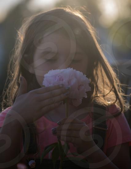 Smelling the flower girl summer photo