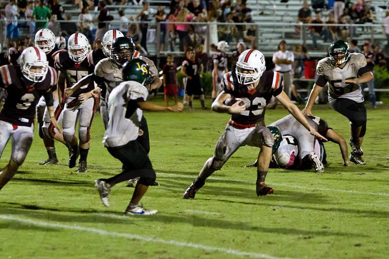 Football player evading a tackle photo