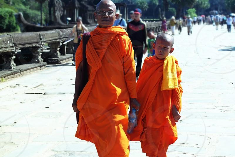 monk wearing orange monk suit photo