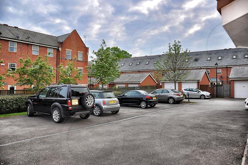 black suv parked near grey mini cooper photo