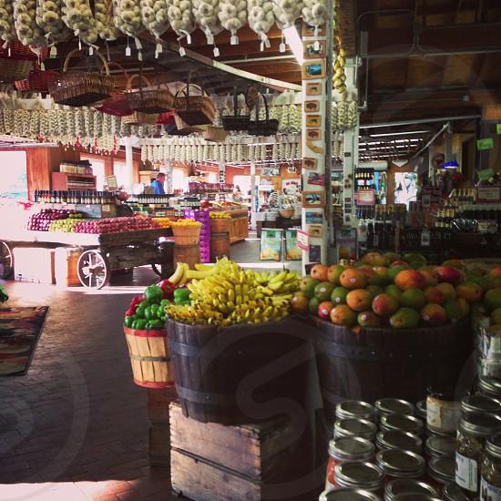 Marketplace. Fruits vegetables mangoes bananas garlic peppers.  photo