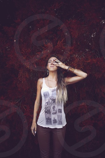 woman in printed white tank top photo
