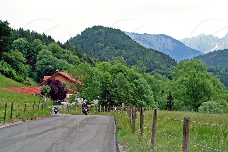 two. motorbikes road Rechenau Bayern Germany green alps mountains photo