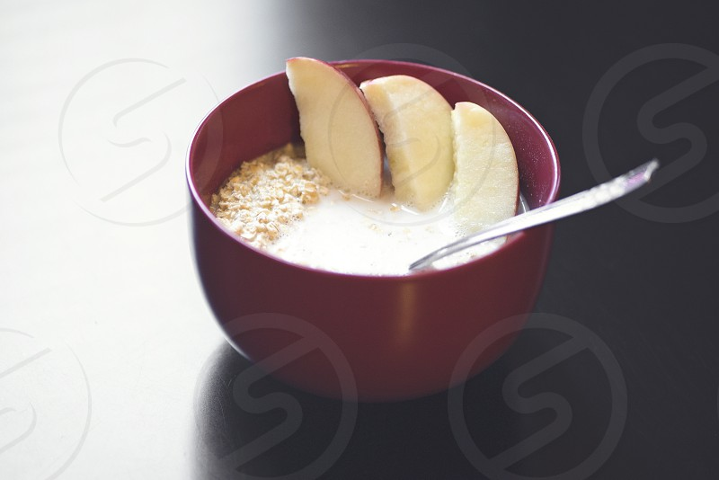 soup with sliced apples on ceramic bowl photo