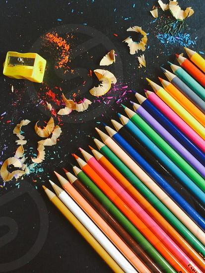 Sharpened Colored Pencils and Yellow Sharpener photo