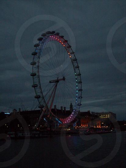 ferris wheel dusk night Thames River London England photo