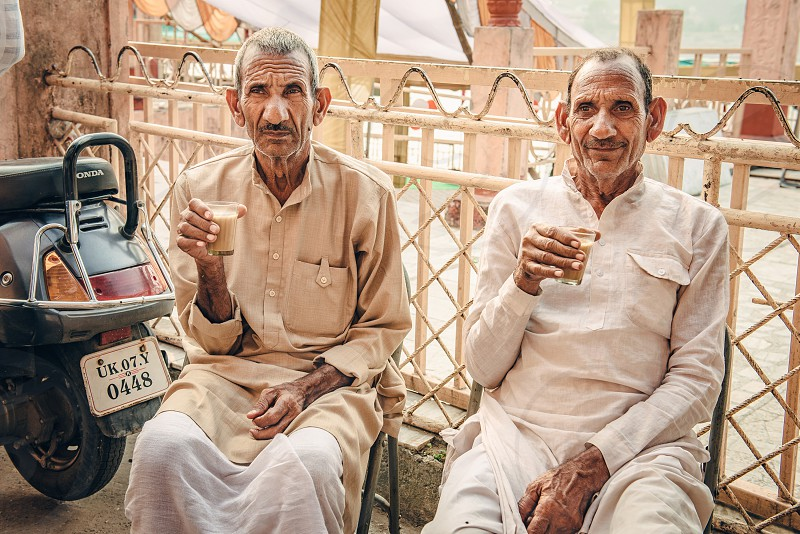 twin brothers have a rest with masala tea photo