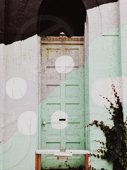 green and brown painted door photo