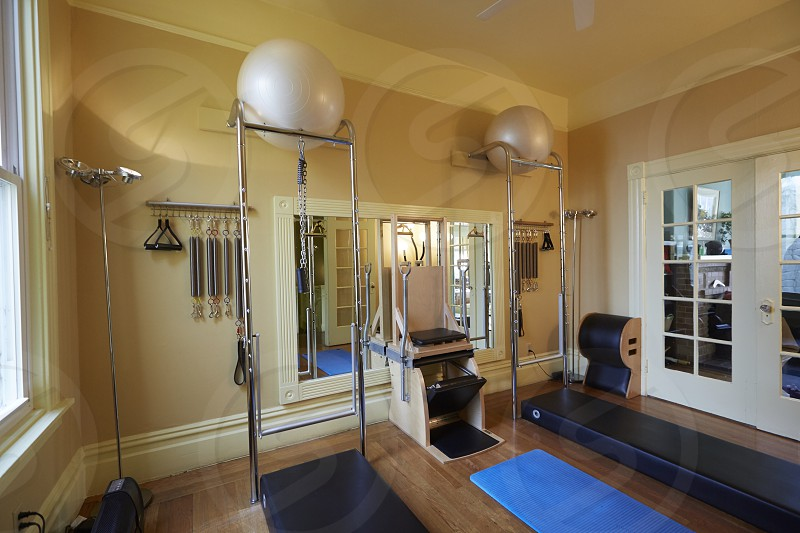 white stability ball on stainless steel rack photo