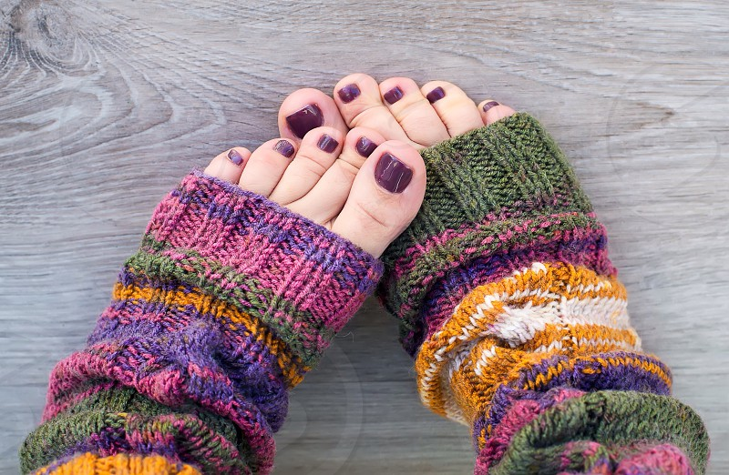 Feet in knitting socks girl women warm home cute pedicure winter spring thread  photo