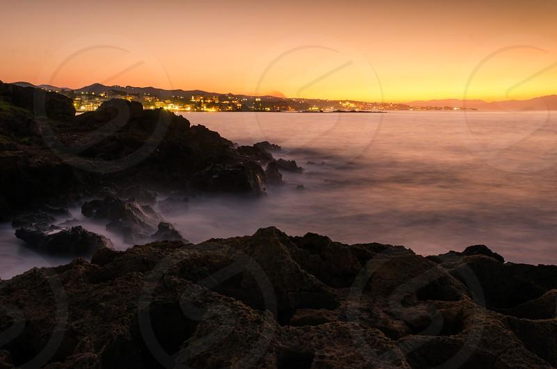 Sunset over Agii Apostoli Chania Crete island Greece photo