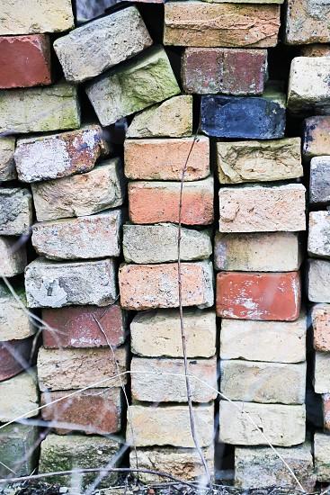Bricks brick pile multicolored colorful  background  wallpaper  clay garden  backyard  construct construction pastels  photo