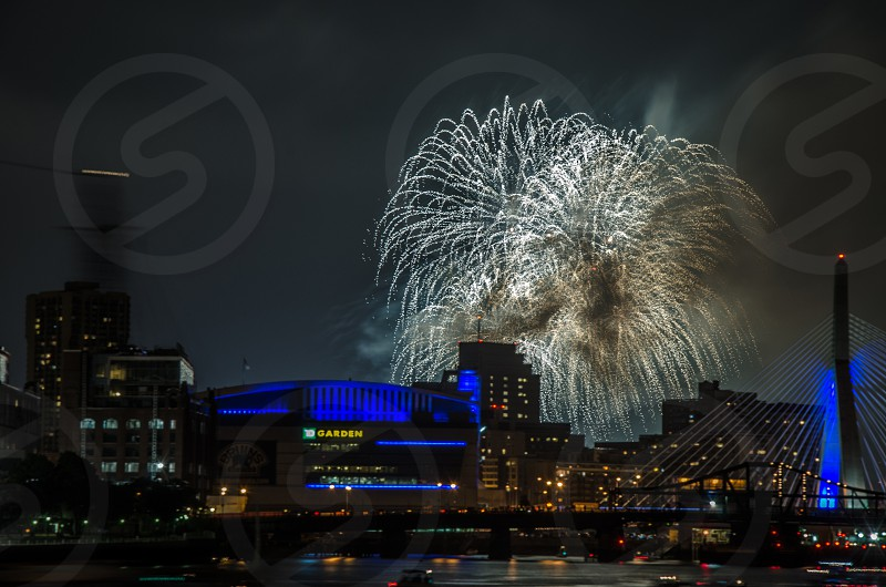 white fireworks display over buildings photo