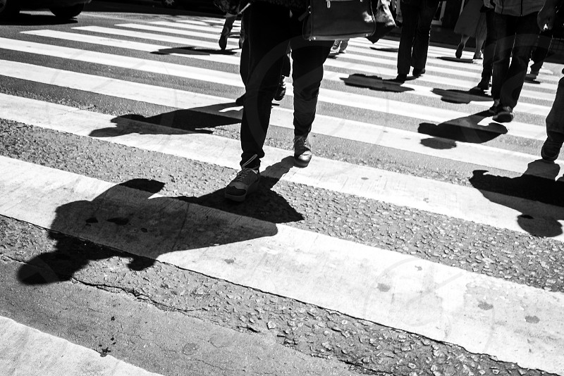 black and white concept art of shadows of diverse group of people walking in the street being all diverse and at the same time the same photo