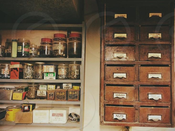 Workshop shelving. Shelves vintage woodworking nuts bolts washers. photo