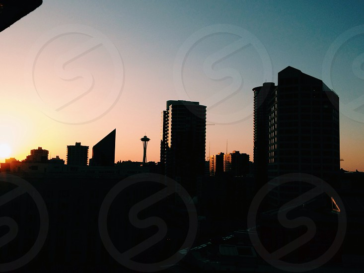 skyline with buildings during sunset photo