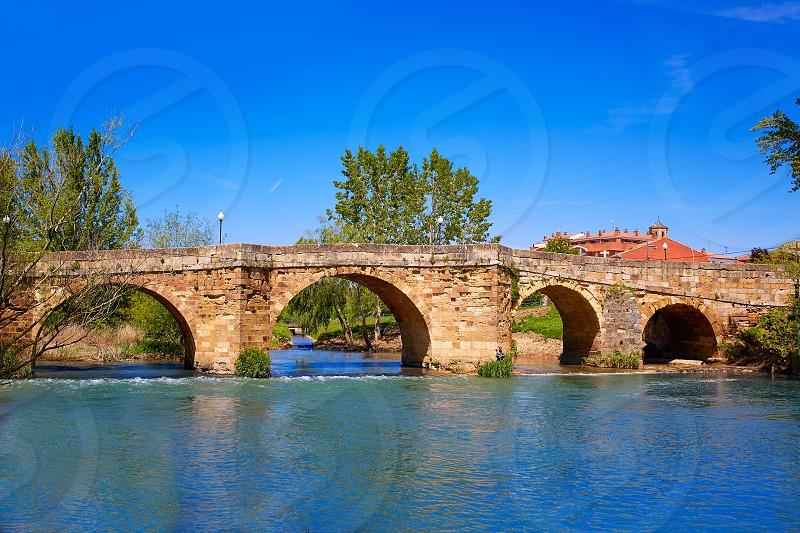 Sahagun river Cea bridge middle center of Saint James Way in Leon Spain photo