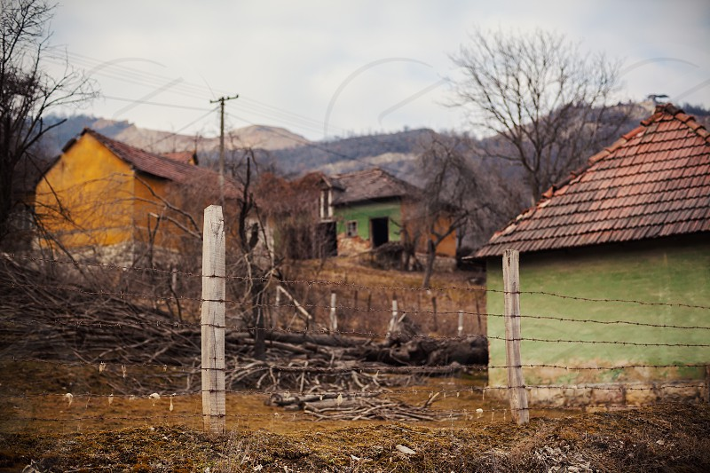 One abandoned village household focus on fence.  photo