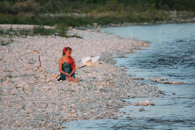 woman sitting near seashore photo