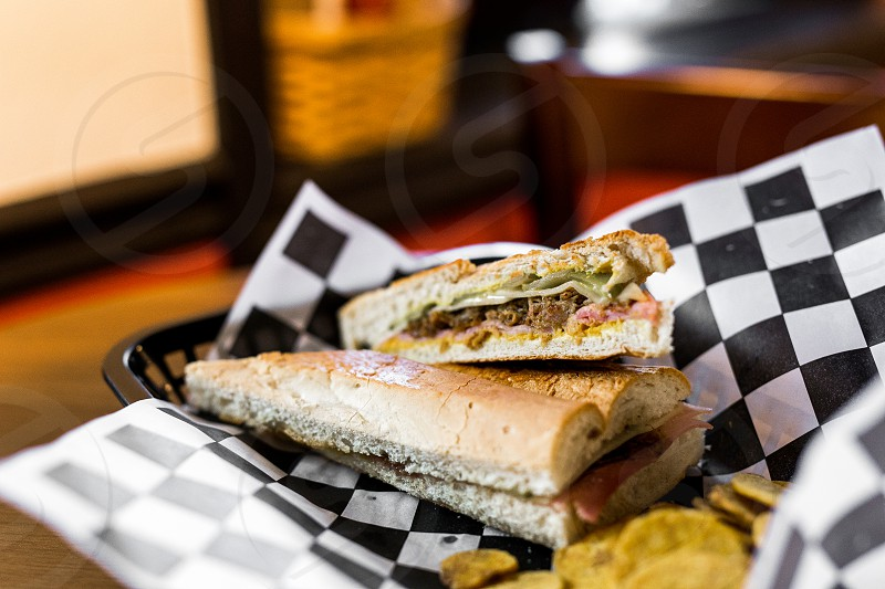 A cuban sandwich and fried plantains. photo