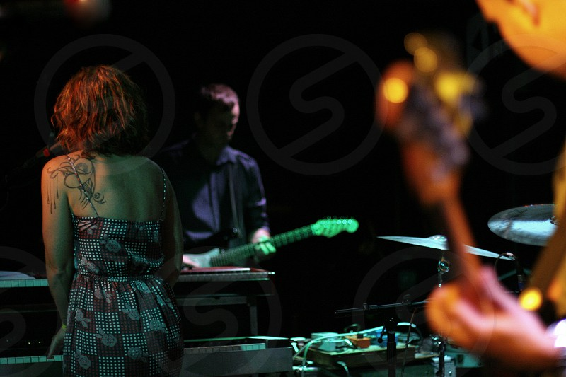 Indie band playing in shadows. photo