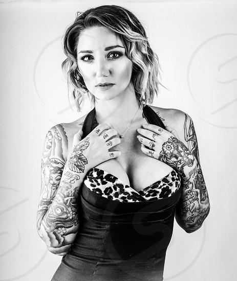 Alternative blonde female model with tattoos portrait in a dress photo