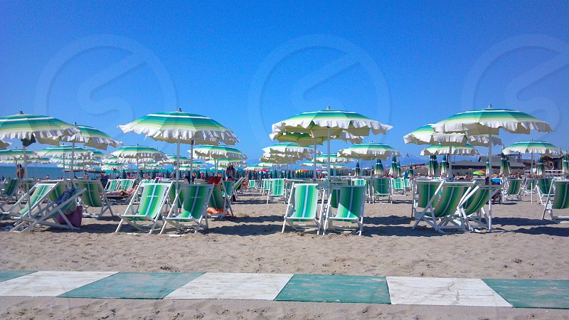 Beach chairs at the southern tip of the Italian Riveria. photo