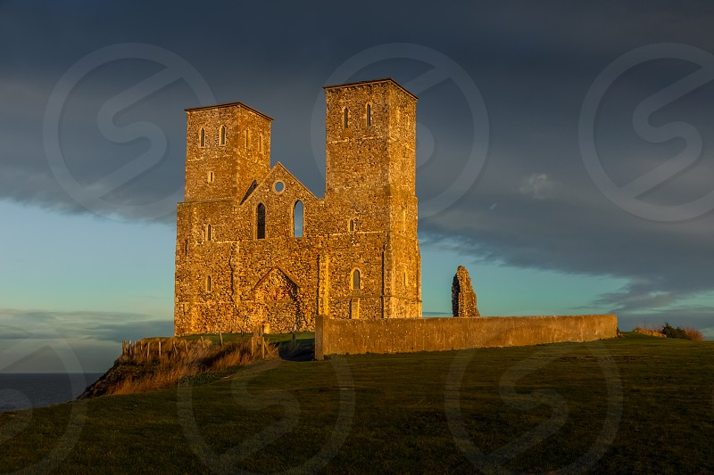 RECULVER ENGLAND/UK - DECEMBER 10 : Remains of Reculver Church Towers Bathed in Late Afternoon Sun in Winter at Reculver in Kent on December 10 2008 photo