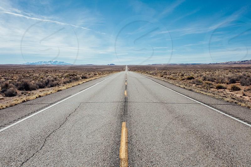 Straight open road leading to the horizon in Utah USA. photo