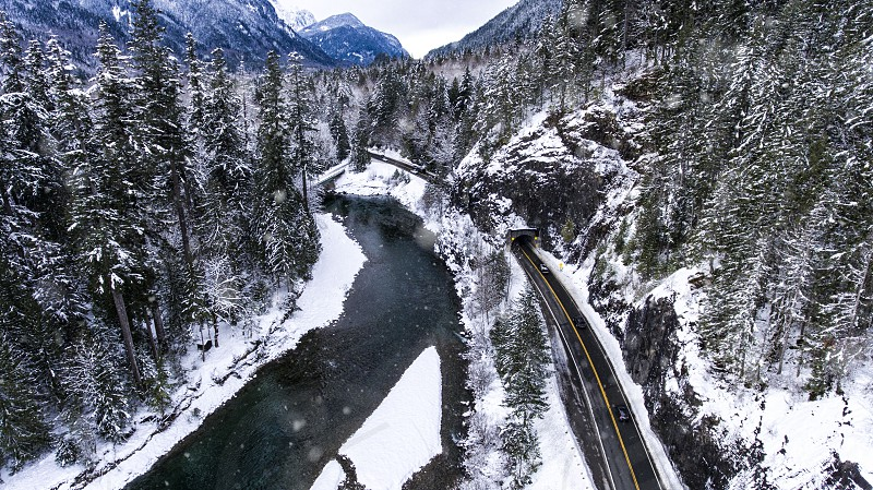 Hwy 2 Stevens pass Washington in snow while snowing from drone photo