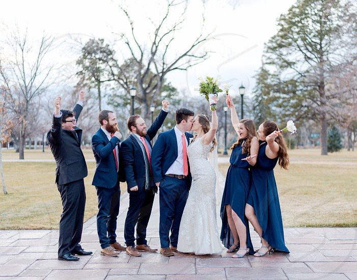 Couple getting married with great friends around them  photo